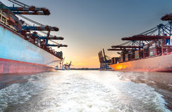 Large container ships in harbor at sunset Royalty Free Stock Image