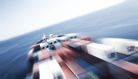 Large container vessel ship and the horizon, motion blur Stock Images