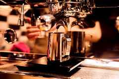 Large contrast shot of coffee with reflection in the Barista equipment. the concept of cooking and love coffee. Beans and drinks. soft colors warm tones royalty free stock photos