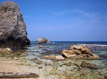 Coral Rocks and Ocean Shore. Large coral rocks form the coastline off the island of Liuqiu in Taiwan Stock Image