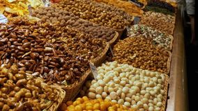 Large Counter of Dried Fruits, Nuts and Sweets at a Market in La Boqueria. Barcelona. Spain. Nuts, dry fruits on display at the market on the showcase. Stall stock video