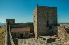 Large courtyard encircled by stone wall at the Marvao Castle. Large courtyard encircled by thick stone wall and square keep on sunny day, in the inner part of stock images