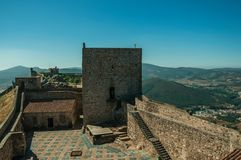 Large courtyard encircled by stone wall at the Marvao Castle. Large courtyard encircled by thick stone wall and squared keep on sunny day, in the inner part of royalty free stock photography