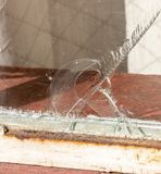 A Large Crack In A Glass Window stock images