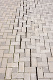 A large crack in paving tiles Royalty Free Stock Images