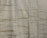 Large cracks on the old canvas cloth. royalty free stock photo