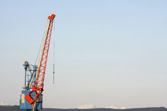 Large crane. Large red and blue crane, copy space royalty free stock images