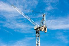Large Crane with blue sky as background Royalty Free Stock Image