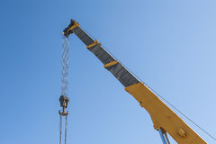 Large crane jib against blue sky background Royalty Free Stock Photo