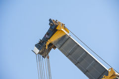 Large crane jib against blue sky background Royalty Free Stock Photography