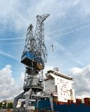 Large crane at the quay of a shipyard in Schiedam, The Netherlands stock image