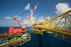Large crane vessel installing the platform in offshore Stock Photos