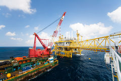 Large crane vessel installing the platform in offshore,crane barge doing marine heavy lift installation works. In the gulf or the sea Stock Photography