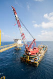 Large crane vessel installing the platform in offshore,crane barge doing marine heavy lift installation works. In the gulf or the sea royalty free stock photo