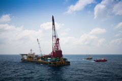 Large crane vessel installing the platform in offshore,crane barge doing marine heavy lift installation works in the gulf. Or the sea royalty free stock image