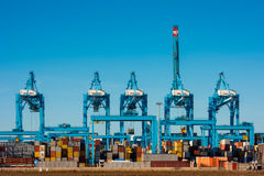 Large Cranes at Container Terminal in Rotterdam Harbour Royalty Free Stock Image