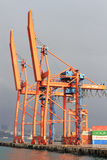 Large cranes in quayside Stock Images