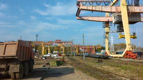 Large cranes at railway station Stock Photography