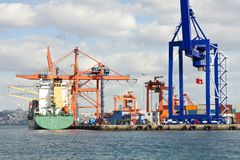 Large cranes in seaport Stock Images