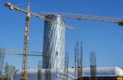 Large cranes working in construction site. BUCHAREST, ROMANIA - SEPTEMBER 12, 2014 : Large cranes working in construction site near Promenada mall Stock Photos