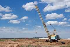 Large crawler crane in the background royalty free stock image