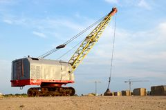 Free Large Crawler Crane Or Dragline Excavator With A Heavy Metal Wrecking Ball On A Steel Cable. Stock Images - 160060154