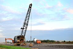 Free Large Crawler Crane Or Dragline Excavator With A Heavy Metal Wrecking Ball On A Steel Cable. Wrecking Balls At Construction Sites Royalty Free Stock Photo - 178414995