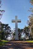 Large cross in a park. Large cross on a hill in a park Royalty Free Stock Images