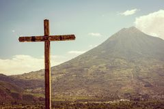 Volcano And Cross In Antigua Guatemala stock images