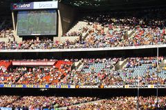 Large crowd. Sit in grandstand for Australian rules football at the telstra dome Melbourne Stock Photo