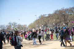 A large crowd of adults and children flying kites at the Kite Festival on the National Mall. WASHINGTON, DC - March 31, 2018: A large crowd of adults and Stock Photos