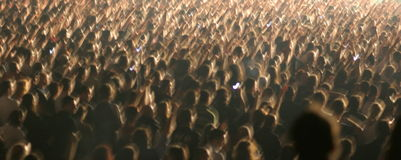 Large crowd with arms movement. Large crowd of people actively attending an event and shaking their arms Royalty Free Stock Image
