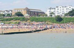Large crowd on beach at Clacton on air show day  from the pier Stock Images