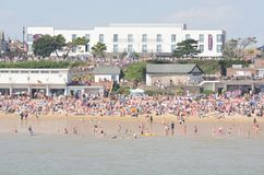 Large crowd on beach at Clacton on air show day viewed from the pier Royalty Free Stock Photo