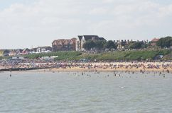 Large crowd on beach at Clacton on sea  on air show day  from the pier Stock Image
