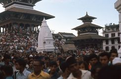 1975. Nepal. Devotees at Durbar Square, Katmandu. A large crowd of devotees are gathered on Durbar square for the yearly Kumari parade. To catch a small glimpse Stock Image