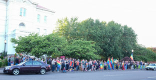 Large crowd gathers with rainbow flags in front of Corvallis Oregon courthouse for Orlando shooting victims Stock Photo