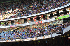 Large crowd in grandstand. Large crowd sit in grandstand for Australian rules football at the telstra dome Melbourne Stock Image