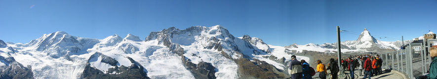 Large crowd in a mountain top cafe enjoying the view of the MATTERHORN stock photos