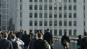 Large crowd of pedestrians walk over London Bridge 14 Stock Photography