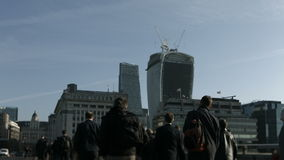Large crowd of pedestrians walk over London Bridge 35 stock video footage