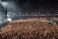 Large crowd of people at a concert in the front of the stage. CLUJ-NAPOCA, ROMANIA - AUGUST 7, 2016: Large crowd of people, audience partying in the front of the Stock Image