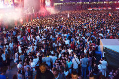 Large crowd of people at a concert in the front of the stage. CLUJ-NAPOCA, ROMANIA - AUGUST 7, 2016: Large crowd of people, audience partying in the front of the Stock Images