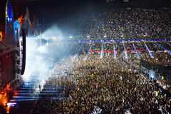 Large crowd of people at a concert in the front of the stage. CLUJ-NAPOCA, ROMANIA - AUGUST 7, 2016: Large crowd of people, audience partying in the front of the Royalty Free Stock Images