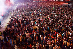 Large crowd of people at a concert in the front of the stage. CLUJ-NAPOCA, ROMANIA - AUGUST 7, 2016: Large crowd of people, audience partying in the front of the Royalty Free Stock Photos