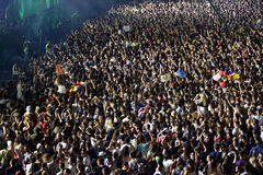 Large crowd of people at a concert in the front of the stage. CLUJ-NAPOCA, ROMANIA - AUGUST 7, 2016: Large crowd of people, audience partying in the front of the Stock Photos