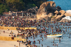 Large crowd of people enjoy the beach. Stock Image