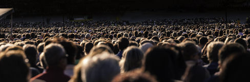 Large crowd of people. Panoramic photo of large crowd of people. Slow shutter speed motion blur stock image