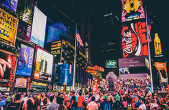 Large crowd of people in Times Square at night, in Midtown Manha Royalty Free Stock Images