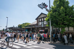 Large crowd of people walking out of Harajuku station in golden week. Royalty Free Stock Image